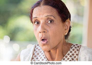 Shocking news - Closeup portrait, elderly woman in white...