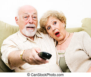 Senior Couple shocked by what they're watching on tv.