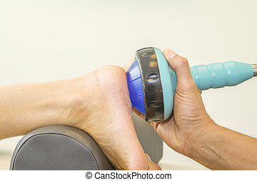 Shockwave treatment on foot sole