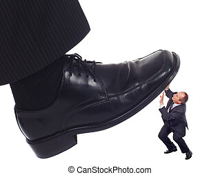 Shoe crushing a businessman - Businessman's foot stepping on...