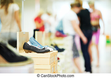 shoe in footwear store - Pair of female shoes standing in...