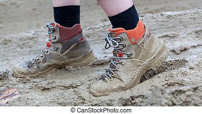 Walking through thick messy mud