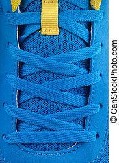 Shoe laces of a blue new sneakers. macro