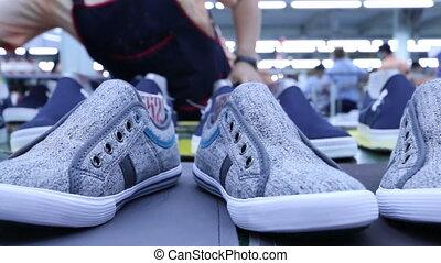 footwear factory production line - shoe on conveyor in...