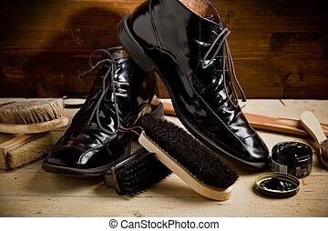 Shoe polishing tools - photo of various brushes on wooden...