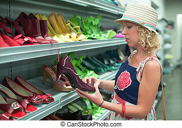 Shoe shopping in a thrift store - Woman shopping for shoes ...