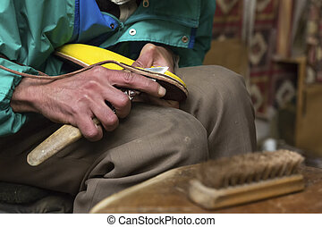Shoemaker at work in Morocco, Africa