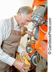 Shoemaker at work