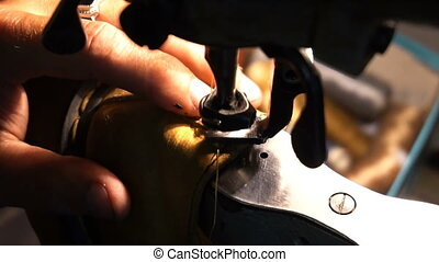 Shoemaker repairing shoes. Workshop - Shoemaker repairing...