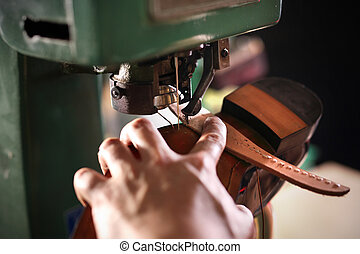Shoemaker sews shoes - Shoes shoemaker sews on the sewing...