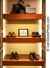 Shoes and bags in man clothing shop