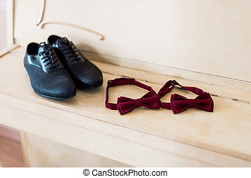 Shoes and bow on the table