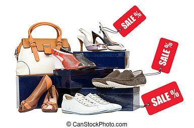 Shoes and handbag on boxes