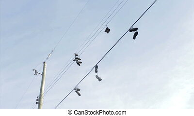 Shoes Hanging From Hydro Wires - A whole bunch of running...