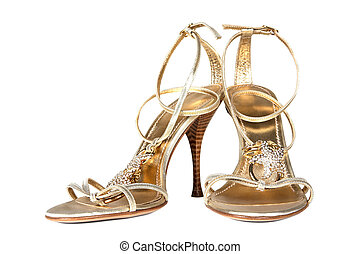 shoes of gold color - Female shoes of gold color on a white...