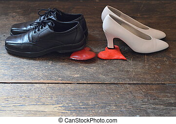 shoes of husband and wife on hearts