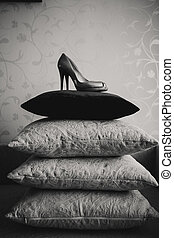 Shoes of the bride on a pillows