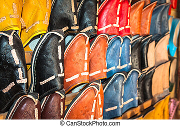Shoes on a shoe stall on the market in Essaouira, Morocco