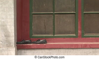Shoes on a Window Frame - Chinese shoes left on an old...