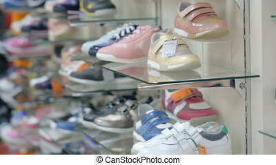 Shoes on shelves at shoe store