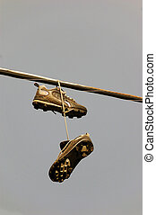 Shoes on telephone wire.