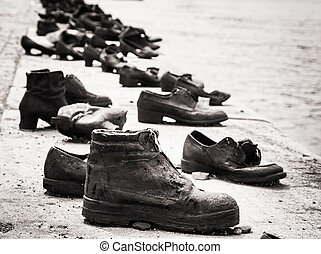 Shoes on the Danube bank is a memorial in Budapest, black...