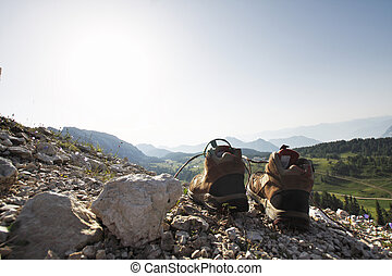 Shoes on the rock - A pair of hiking shoes on the rock