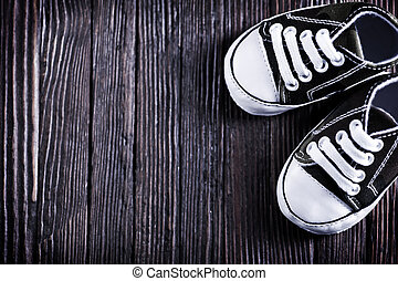 shoes - baby shoes on the wooden background, shoes on a...