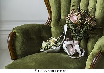 Shoes with a wedding bouquet