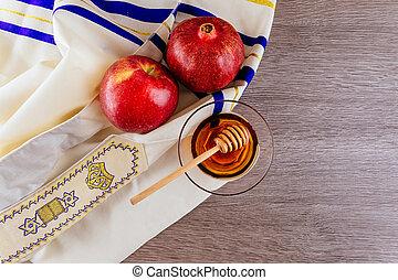 shofar horn , white prayer talit and pomegranate isolated on...