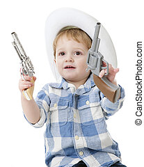"An adorable 2-year-old ""cowboy"" wielding a toy gun in each hand. On a white background."