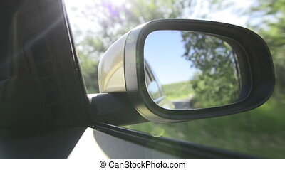 Shoot in rear-view mirror of car