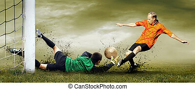 Shoot of football player and goalkeeper on the outdoors field