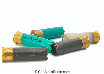 shooted multi-coloured cartridges on a white background