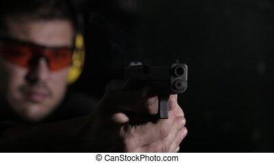 Shooting a gun on black background