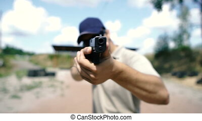 Shooting. A man is practicing tactical shooting with a pistol at a shooting range.
