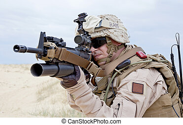 shooting - aiming a gun with grenade launcher