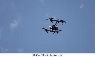 Shooting copter flight - In blue sky hanging copter with...