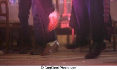Shooting dancing feet of people in the club.