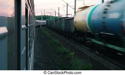 Shooting from a moving train. In the opposite direction on...