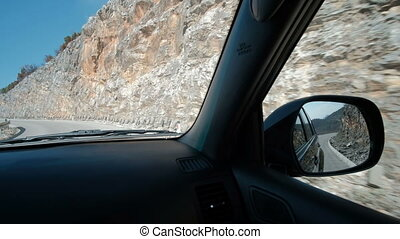 Shooting from salon car drives moving at fast speed along winding