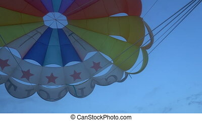shooting from the bottom of the parachute during flight,...