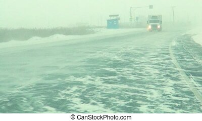 shooting from the cab when driving on a winter road in Siberia, in snowy weather