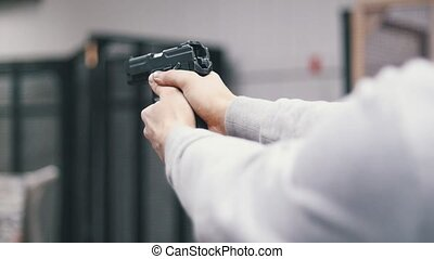 Shooting gallery. A young man shooting. Close up hands