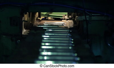Shooting inside cylinders being delivered to conveyor belt in factory