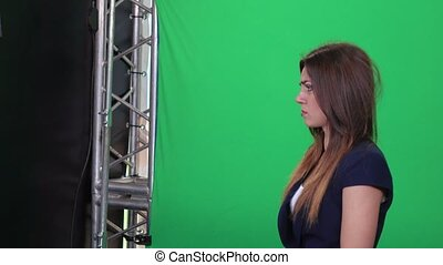 Shooting model on green background - Girl actress playing on...
