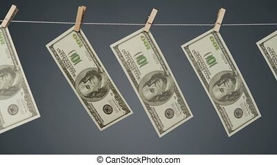 Video of dollars hanging on clothesline rope