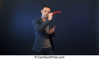 Video of magician showing different tricks on blue background