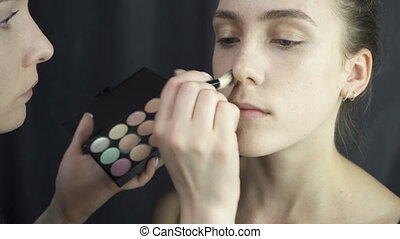 Shooting of master applying foundation makeup - Video of...