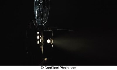 Video of old film projector on black background
